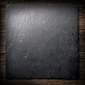 Black tile on wood