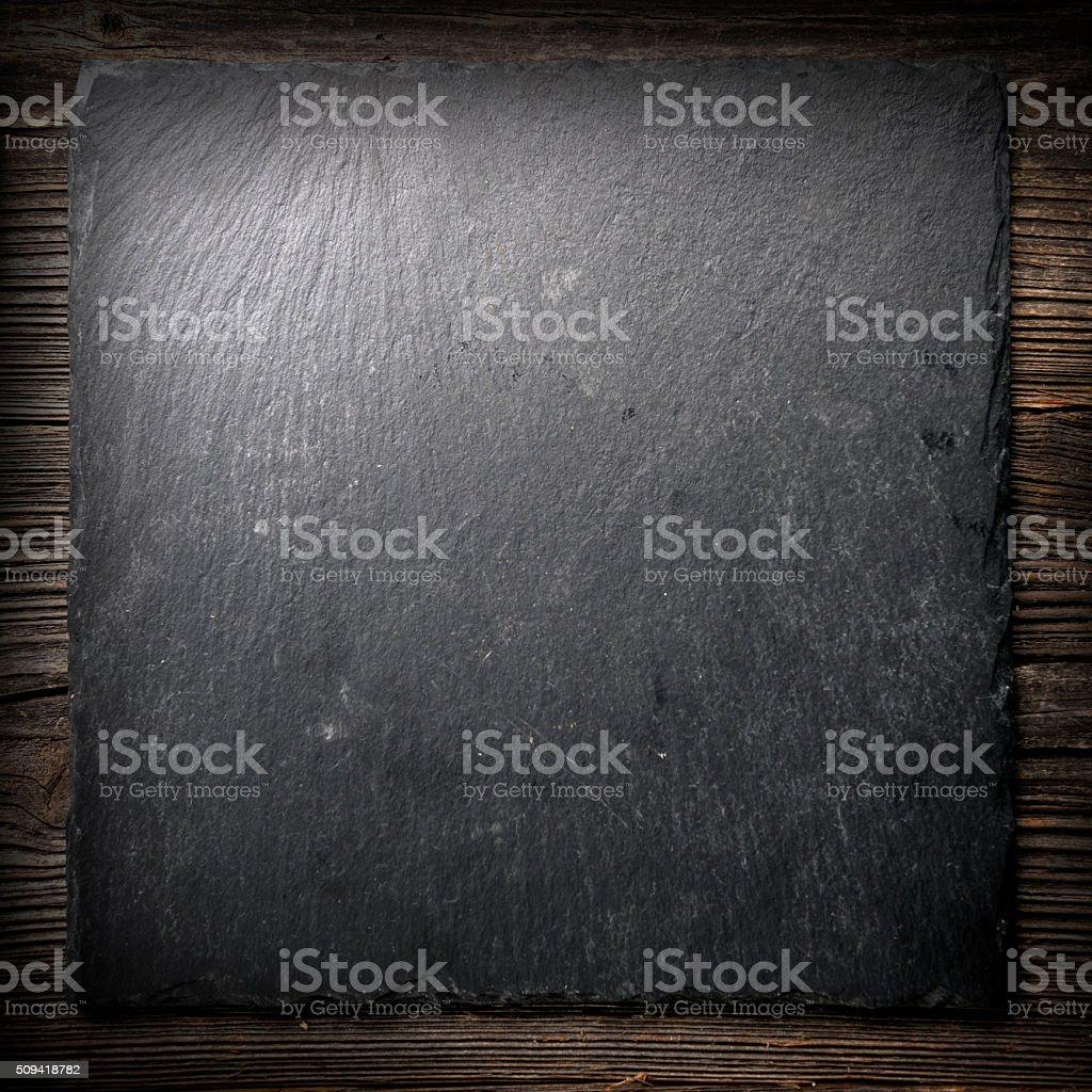 Black tile on wood stock photo