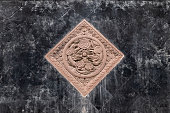 Black tiles floor with brown stone carving of dragons in chinese park