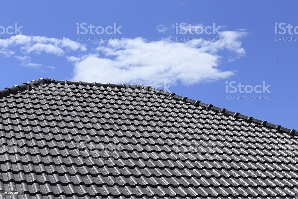 black tiles roof on a new house stock photo