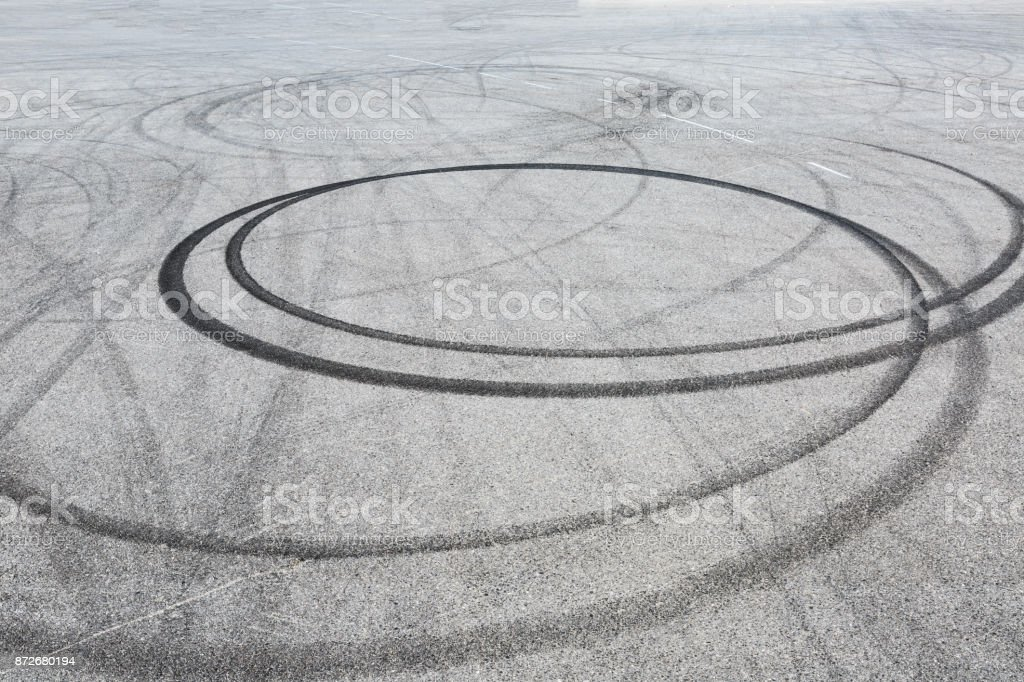 black tire tracks skid on asphalt road,abstract background stock photo