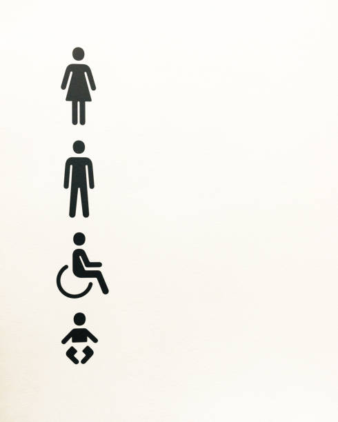 Black toilet signs on a white background (male, female, wheelchair and baby). stock photo