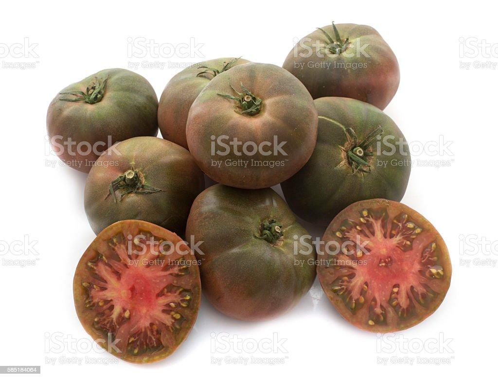 black tomatoes in studio stock photo