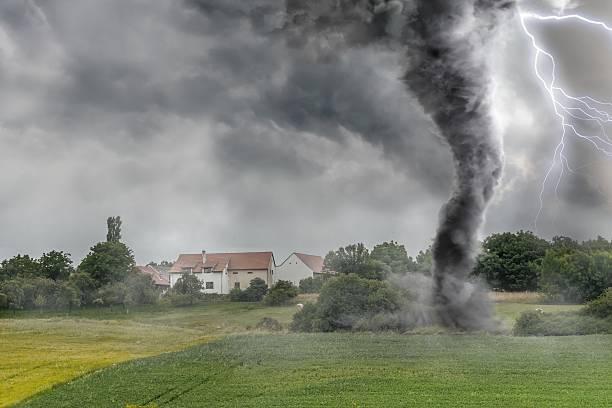 black tornado funnel and lightning over field during thunderstor - tornado stockfoto's en -beelden