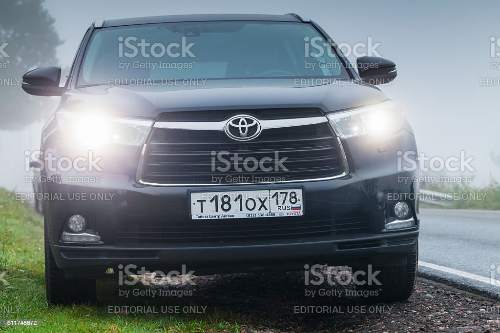 Black Toyota Highlander car in foggy morning stock photo