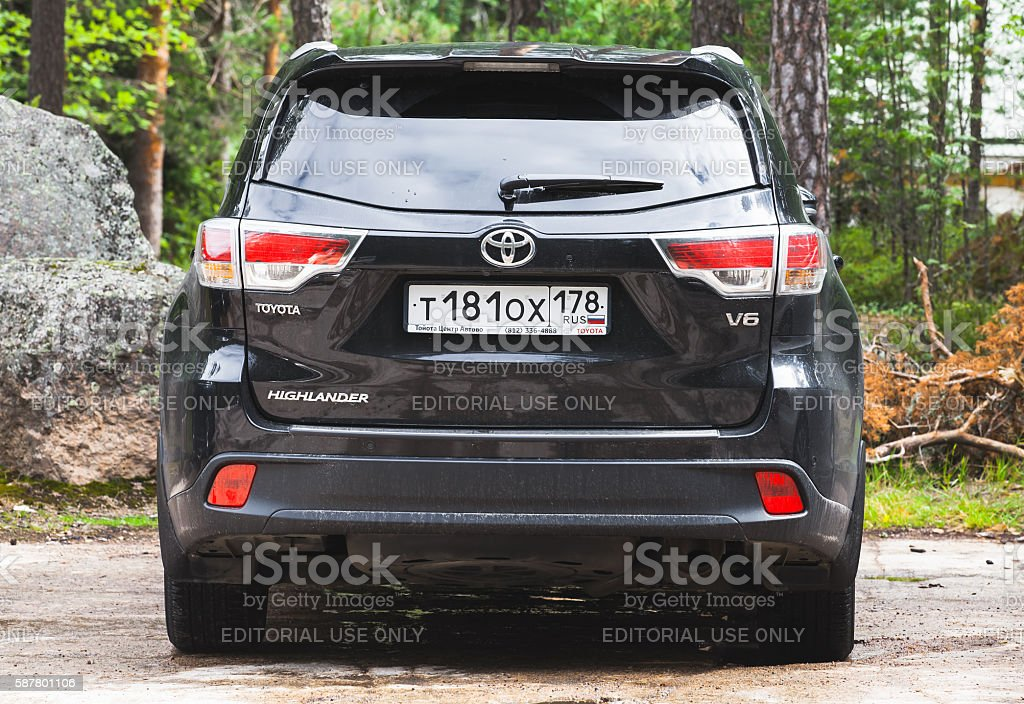 Black Toyota Highlander car,  rear view stock photo