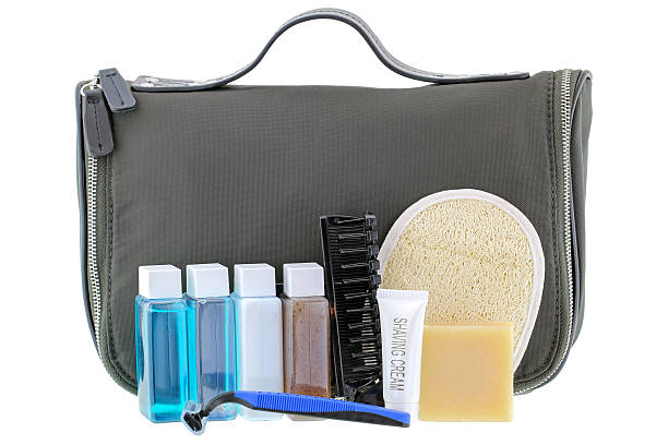 Black traveling cosmetic bag with toiletries, isolated on white stock photo