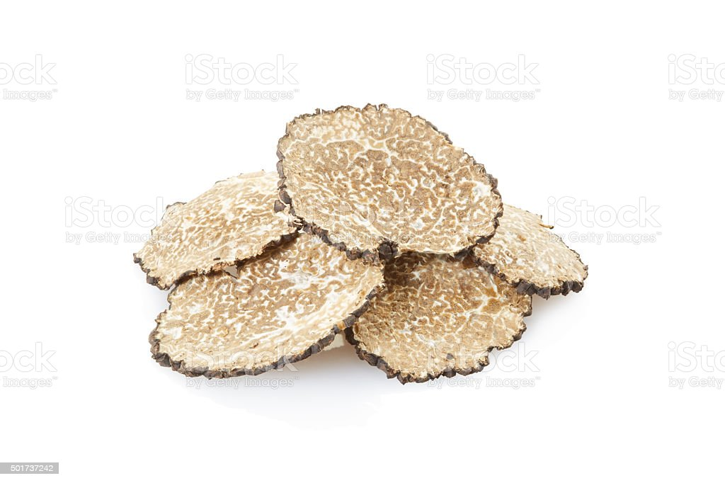Black truffle slices heap on white stock photo