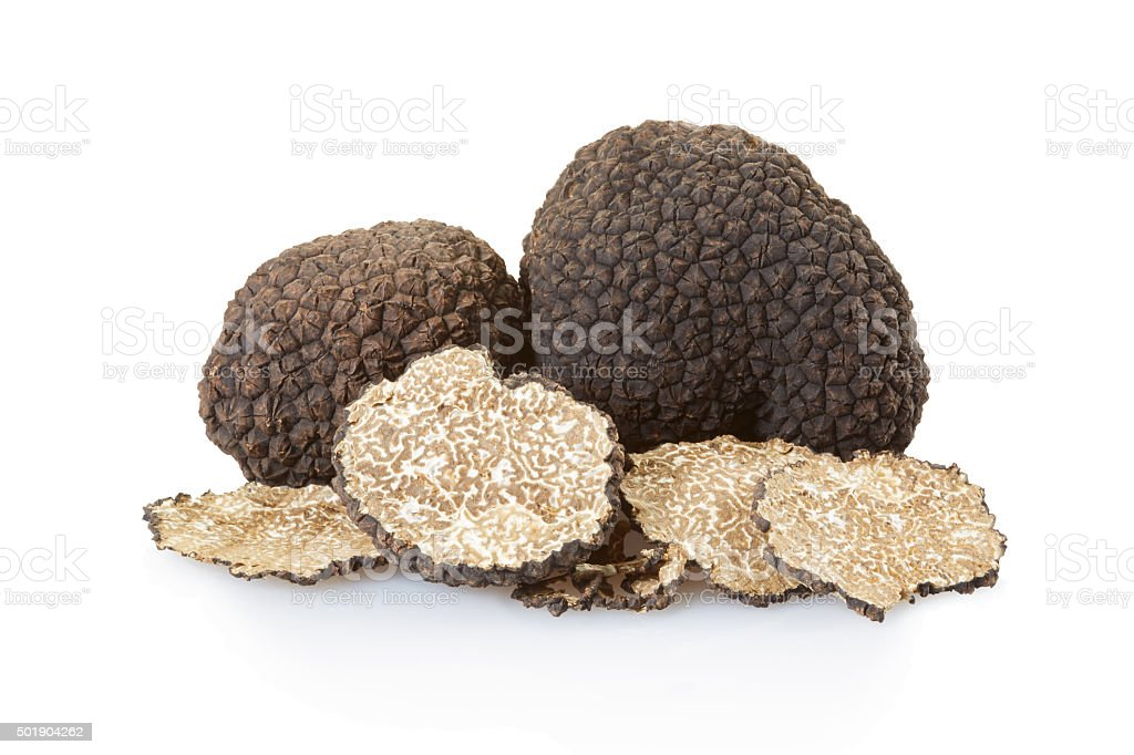 Black truffles group and slices on white stock photo