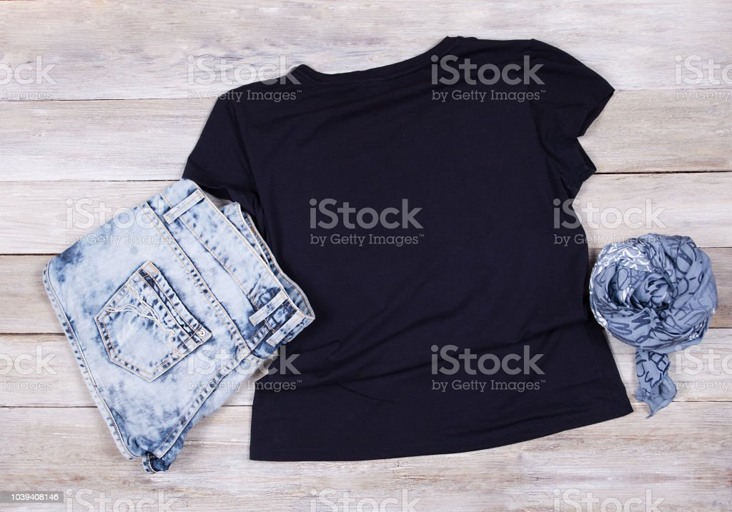 Black T-Shirt Mockup - Short Sleeve T-Shirt Flat Lay stock photo