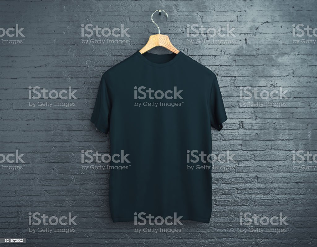 Black t-shirt on brick background stock photo