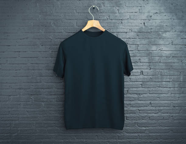 black t-shirt on brick background - t shirt stock photos and pictures
