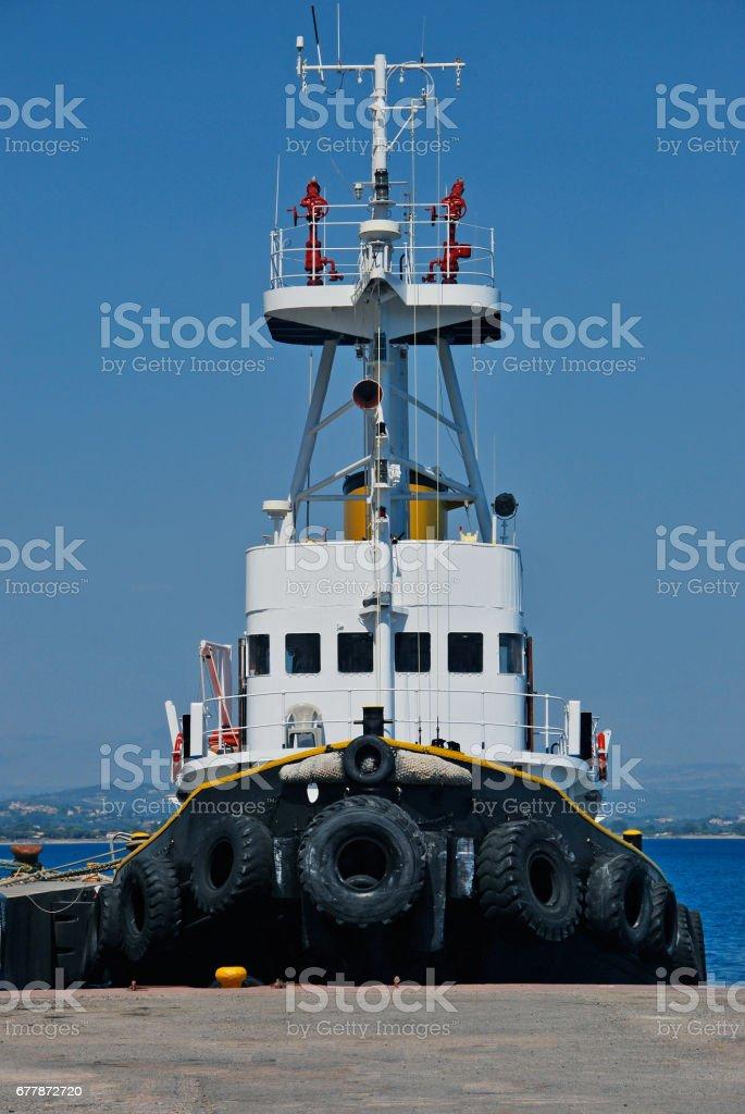 Black tugboat stock photo