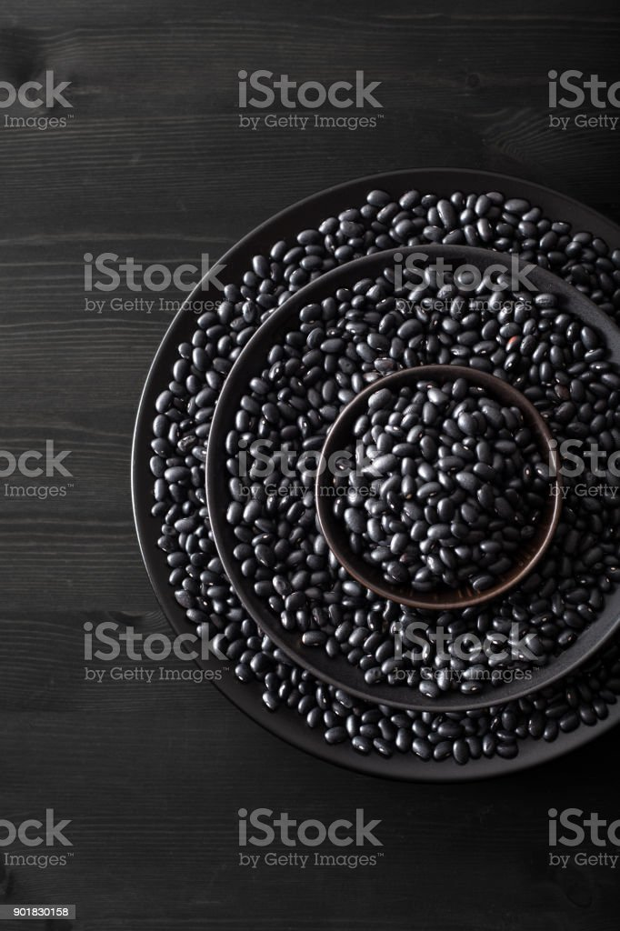 black turtle beans legumes in bowls stock photo