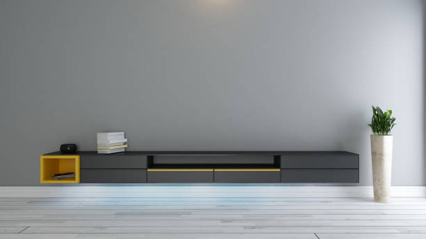 black tv stand with plant decor stock photo