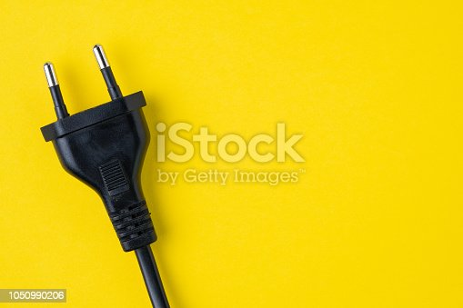 istock black type C electric plug connector on yellow background with copy space, power and energy consume, eco or unplugged concept 1050990206