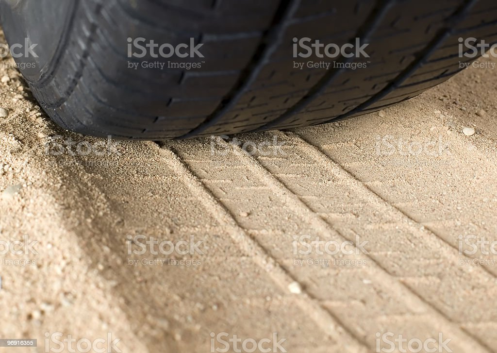 Black tyre and track on sand royalty-free stock photo