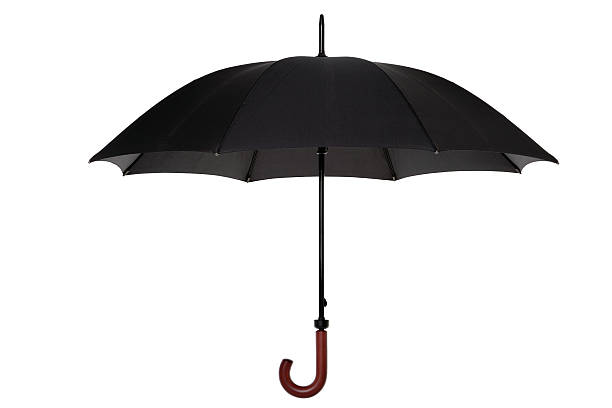 Black umbrella isolated stock photo