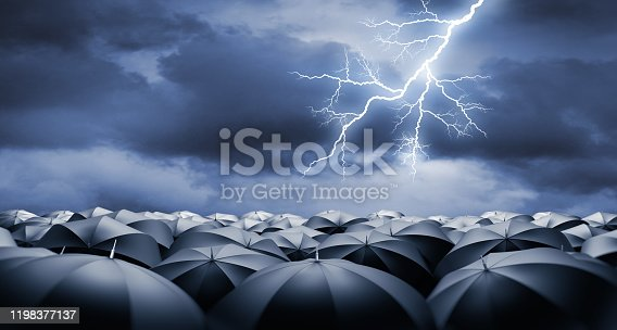 Crowd of black Umbrellas in thunderstorm and lightning