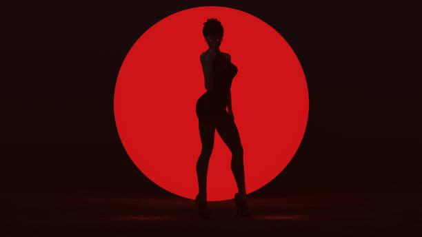 black vampire devil woman in small black dress standing with a big red sphere in a dark foggy void seductive front view - seduzione foto e immagini stock