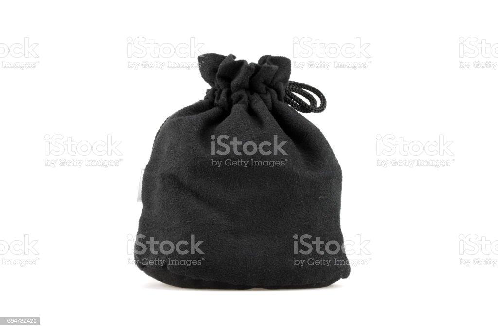 Black velvet pouch on white background stock photo