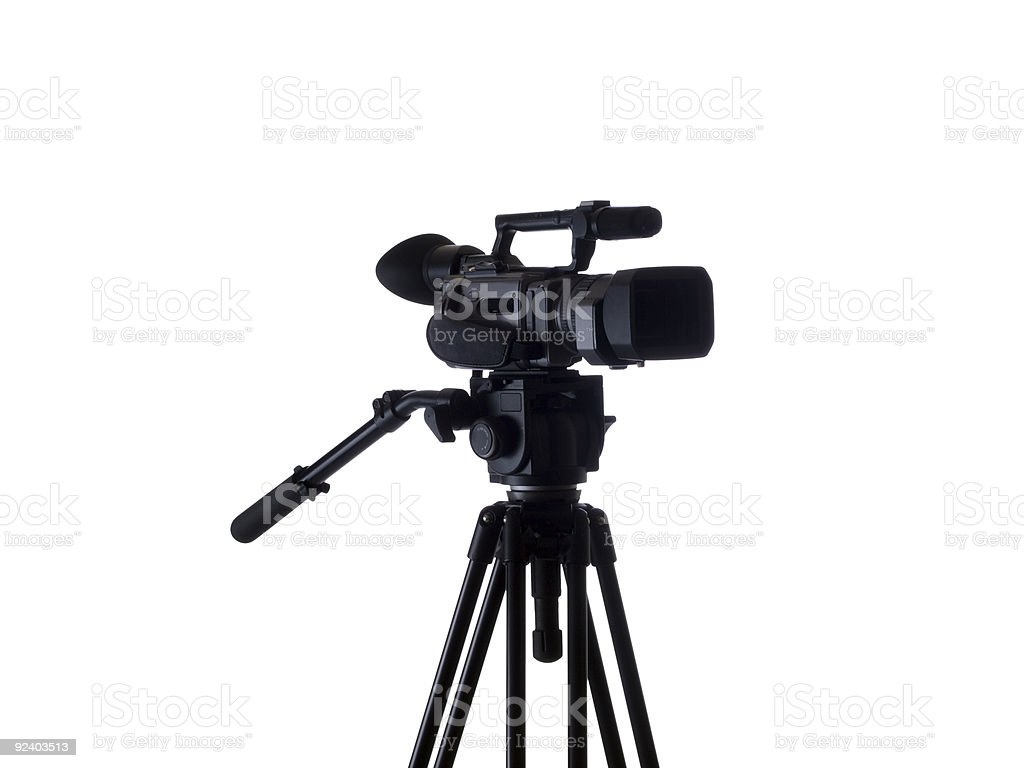 Black video camera mounted on tripod 3/4 view royalty-free stock photo