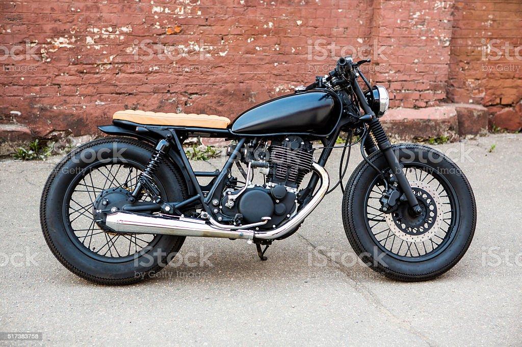 Black vintage custom motorcycle cafe racer stock photo