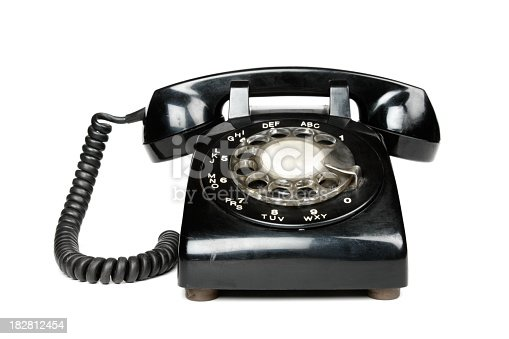 A black rotary telephone, isolated on a white background.