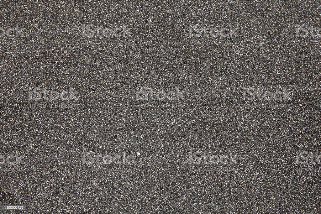 Black Volcanic Sand Background stock photo