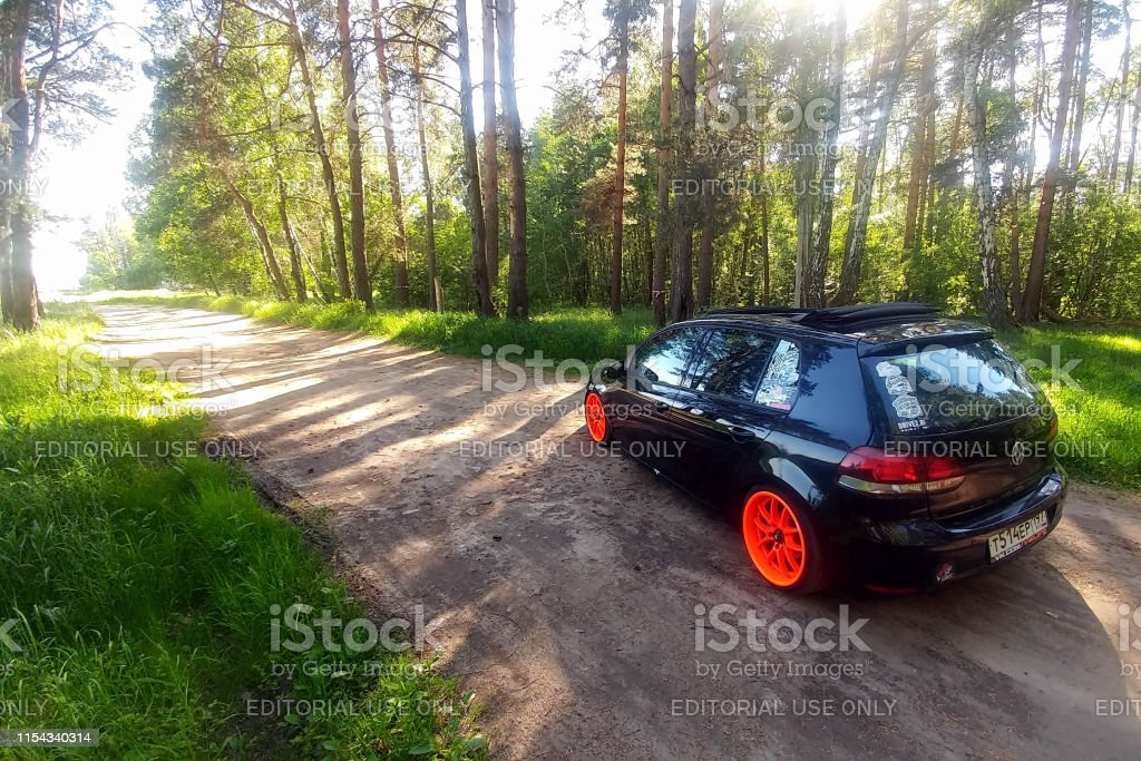 Black Volkswagen Golf Mk6 tuned with ragtop and orange wheels. Stance...