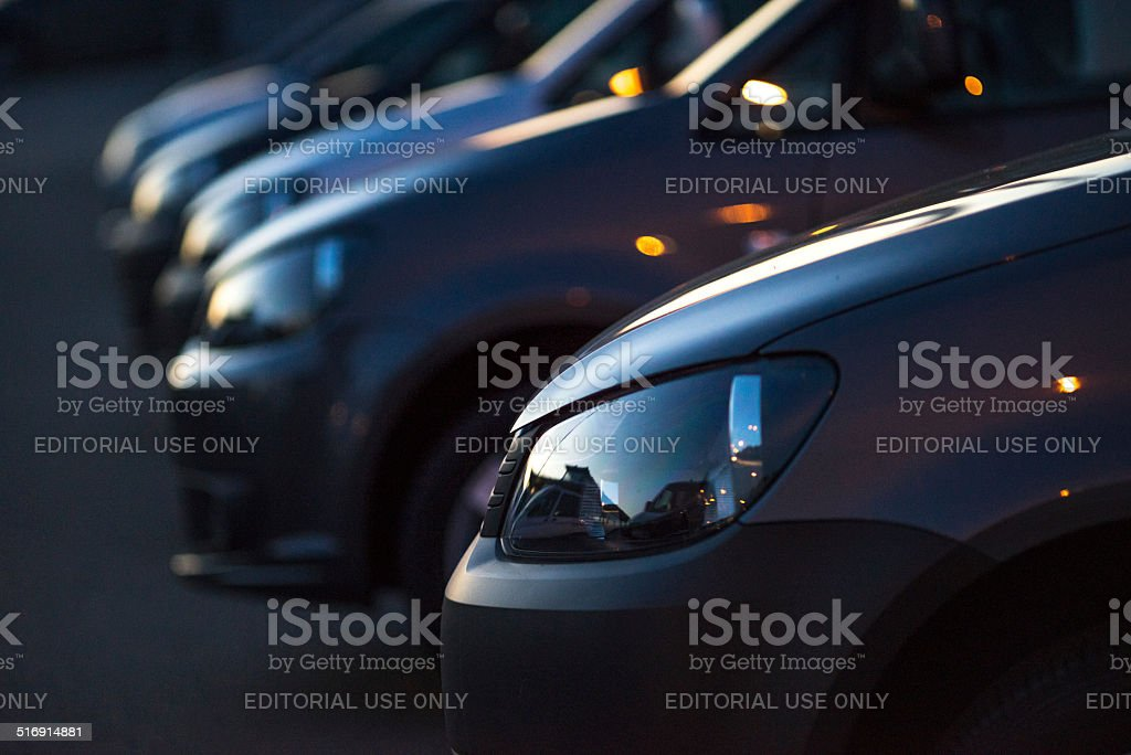 Black Volkswagen vehicles at night stock photo