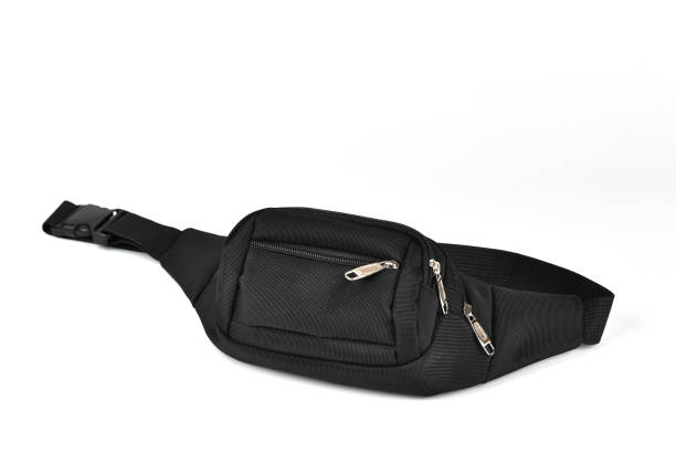 black waist bag isolated on a white background - waist bag stock photos and pictures