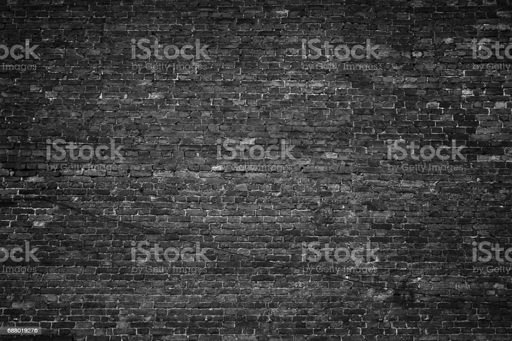black wall, brick texture, dark background stock photo