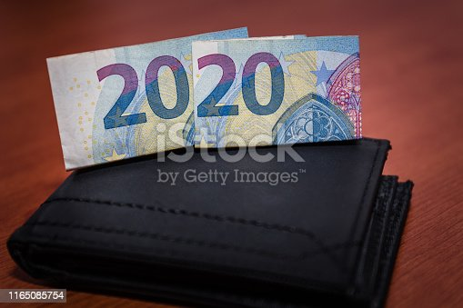 1170746979istockphoto black wallet with euro banknotes 1165085754