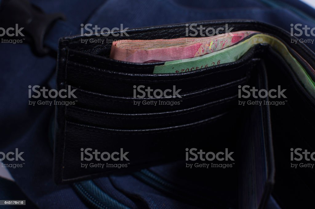 Black wallet with money baht.