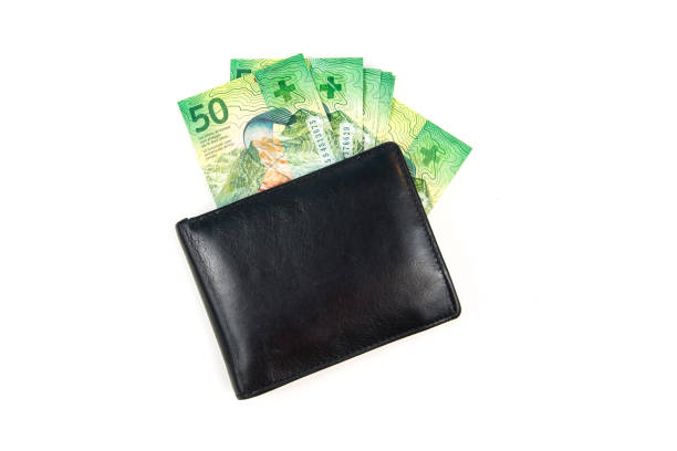 Black wallet with Swiss Francs on white background stock photo