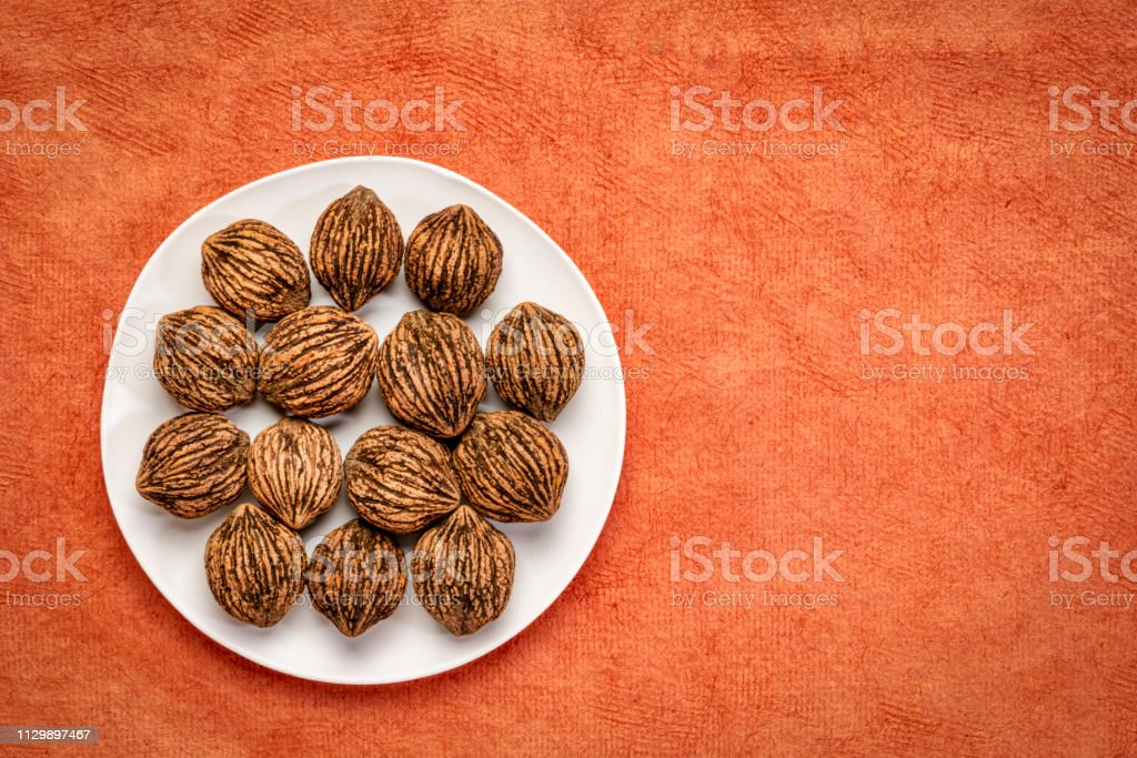 black walnuts on a white plate stock photo