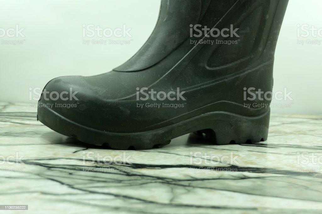 Black warm feminine boots Winter shoes isolated on white background