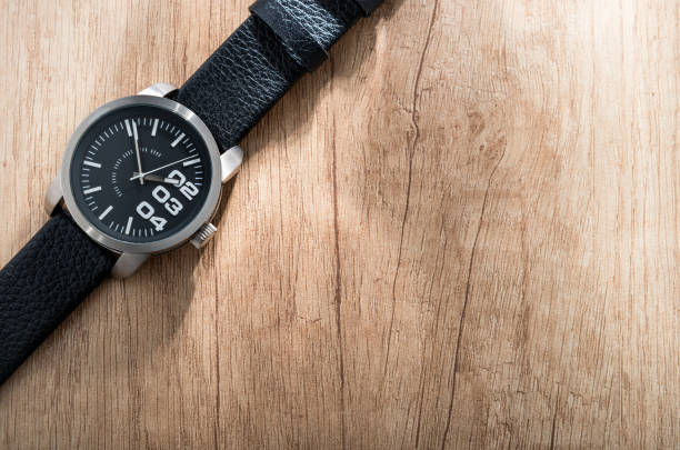 Black watch on wooden background stock photo