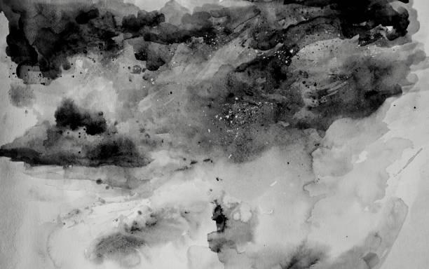 Schwarzes Aquarell auf Papier. Abstrakte Wolken. – Foto