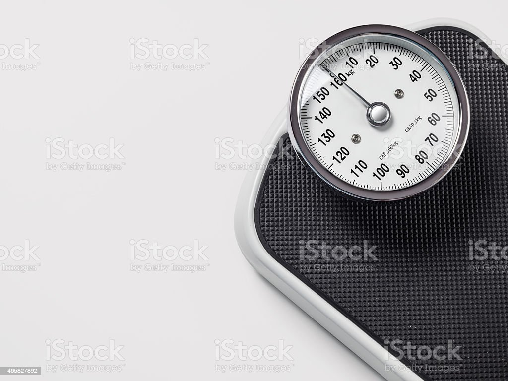 Black weighing scales on white background stock photo