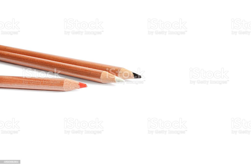 Black, white and red  pencils in white background stock photo