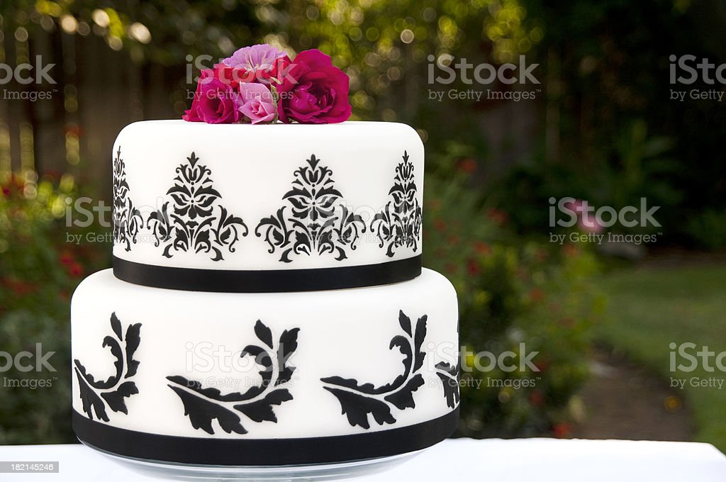 Black & White decorated wedding cake in outdoor setting