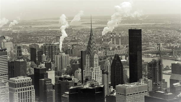 black & white manhattan skyline in new york - chrysler building stock photos and pictures