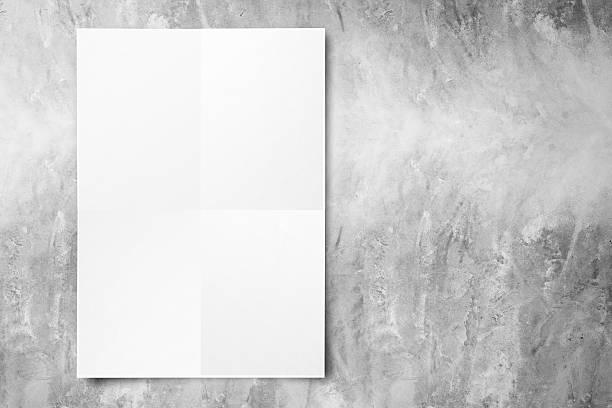 black white paper poster aufhängen an betonwand - klapprahmen stock-fotos und bilder