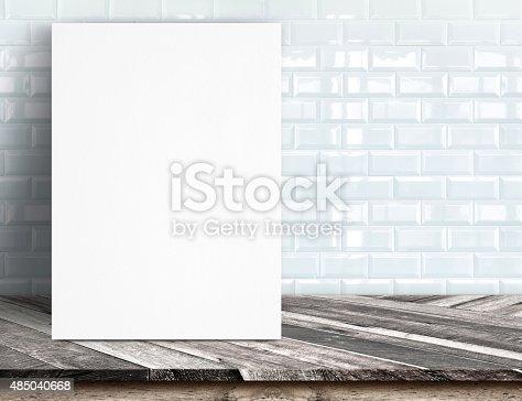 istock Black White paper poster lean at white ceramic tile wall 485040668