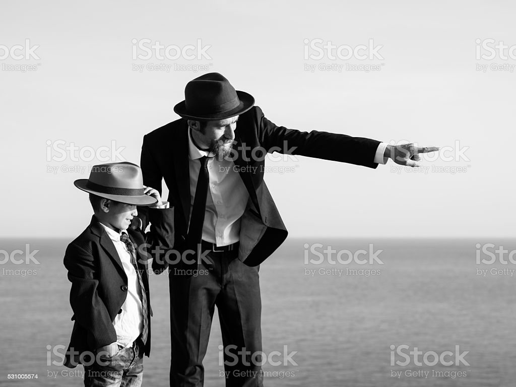 Black, White Portrait Of Father And Son Having Good Time stock photo