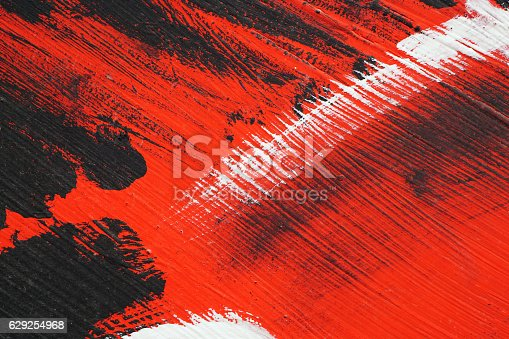 629255068 istock photo Black, white, red acrylic paint on metal surface. Brushstroke 1 629254968