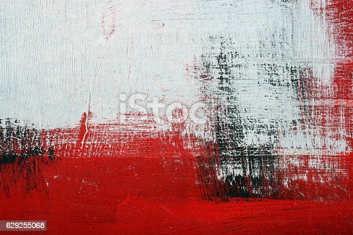 istock Black, white, red acrylic paint on metal surface. Brushstroke 2 629255068