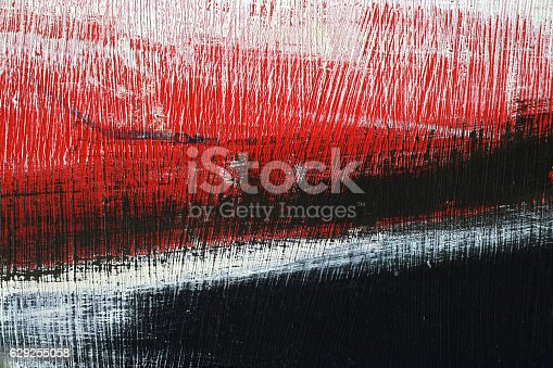 629255068 istock photo Black, white, red acrylic paint on metal surface. Brushstroke 5 629255058